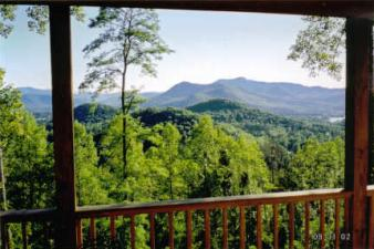 See the North Carolina mountains from the deck of this home in Hiawassee, GA